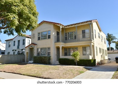 Luxury custom made houses and mansions with  landscaped front yard in the rich suburb of Los Angeles, CA.