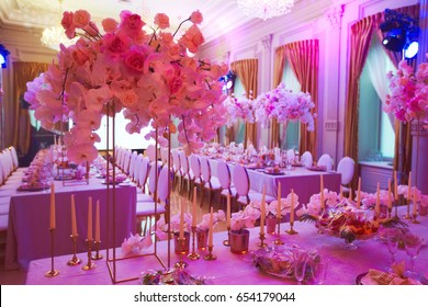 Luxury decorated with flowers roses and orchids celebration hall in palace