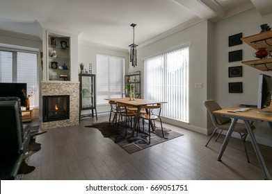 Luxury dining room, fireplace and a small office. Interior design.