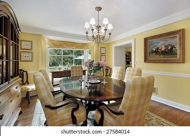 Luxury dining room with yellow tones