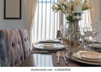 luxury dining table with table set in classic dining room, wooden table with classic chair style, interior design concept