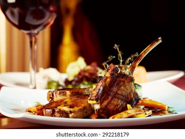 luxury dinner served on  the table with glass of red wine