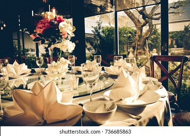 Luxury dinning table, set up for special occasions for special people. In vintage style, mood and tones.