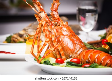 a luxury dish of lobster roasted and decorated with many items of vegetable