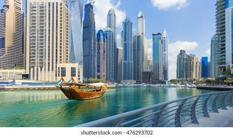 Luxury Dubai Marina canal and promenade in beautiful summer day,Dubai,United Arab Emirates