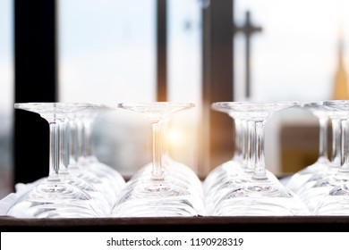 Luxury empty glasses for alcohol on bar counter, Rows of empty wine glasses on showcase to prepare for the party.