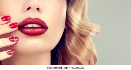Luxury fashion style, manicure nail , cosmetics and makeup . Red  beauty lips  .