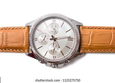 Luxury fashion watches with white dial and brown stitched leather, Vintage style wrist for Men's isolated on a white background. Selective focus, Top view