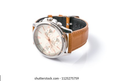 Luxury fashion watches with white dial and brown stitched leather, Vintage style wrist for Men's isolated on a white background. Selective focus.