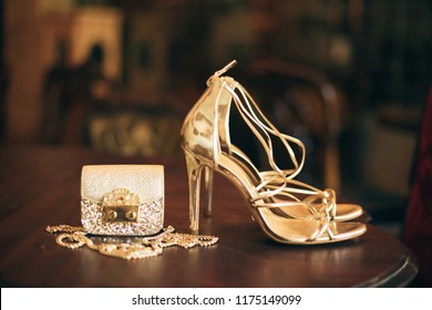 luxury fashion woman accessories, golden heeled shoes, little evening purse, elegant style, vintage style, sandals footwear