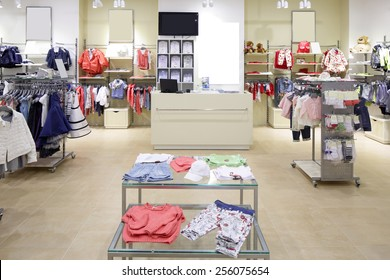 luxury and fashionable brand new interior of kids cloth store