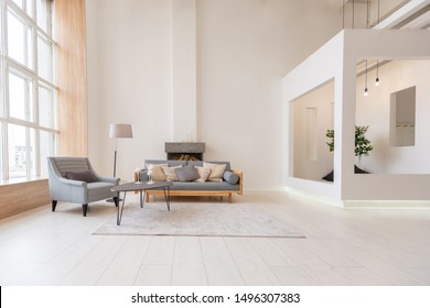 Luxury fashionable modern design studio apartment with a free layout in a minimal style. very bright huge spacious room with white walls and wooden elements. sitting area with fireplace