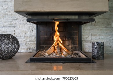 Luxury Fireplace. Fireplace in a modern luxury home with burning fire.