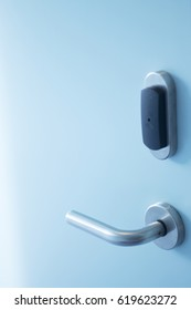 Luxury five star hotel bedroom door and aluminium metal door handle and security key card pass entry swipe.