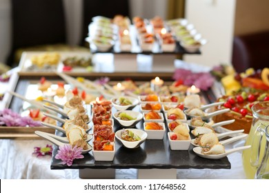 Luxury food and drinks on wedding table. Shallow DOF