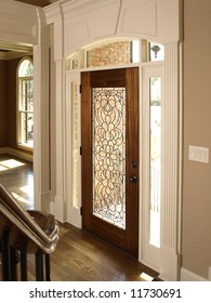 Luxury Foyer with Ornate Stained Glass door