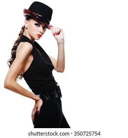 Luxury glamour elegant adult girl in black dress with stylish black hat