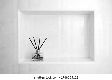 luxury glass aroma scent reed diffuser bottles with yellow oil are displayed in the nice white toilet bahtroom