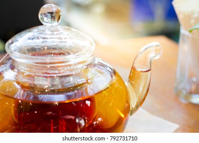 Luxury glass tea pot on the table close up.