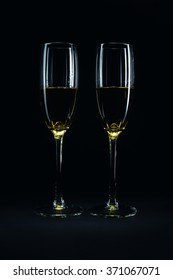 Luxury glasses with wine, studio isolated on black background.