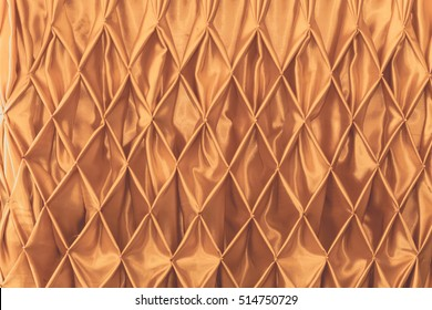 Luxury gold fabric background with beautiful waves,  texture