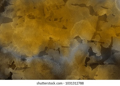 Luxury gold watercolor ombre leaks and splashes texture on white watercolor paper background. Natural organic shapes and design.