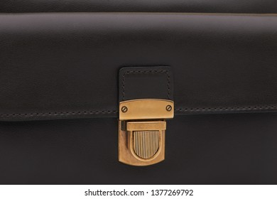 luxury golden lock clasp on black leather bag, close-up