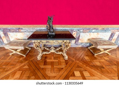 Luxury golden and marble table and stools inside the Royal Palace of Versailles in France