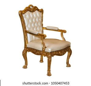 Luxury golden wooden chair with beige leather. Antique armchair isolated on white background