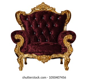 Luxury golden wooden chair with red textile. Antique armchair isolated on white background