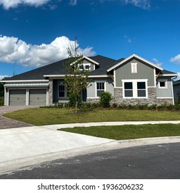 A luxury gray house in the Laureate Park neighborhood in Lake Nona Orlando, Florida.