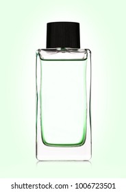 Luxury green liquid perfume bottle on green background with reflection
