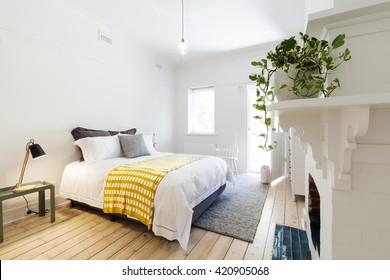 Luxury guest bedroom in vintage scandi styled Australian home