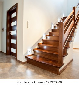 Luxury hallway with wooden stairs to bedroom on teh floor