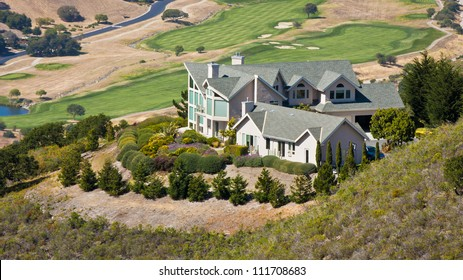 A luxury hillside home overlooking a golf course.