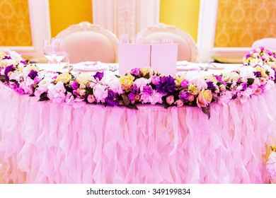 Luxury holiday or wedding  table, richly decorated with beautiful floral bouquets. Floral compositions with fresh roses.