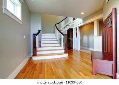 Luxury home beautiful hallway with large grand staircase and hardwood floor.