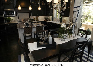 Luxury home dining room and modern kitchen.