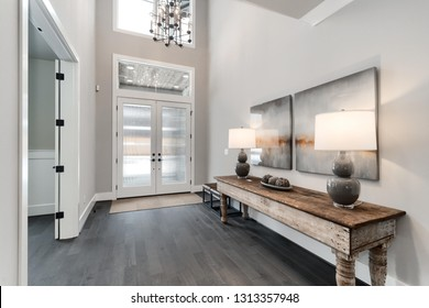 Luxury home entrance with grey and white interior and beautiful furniture in a new contemporary home