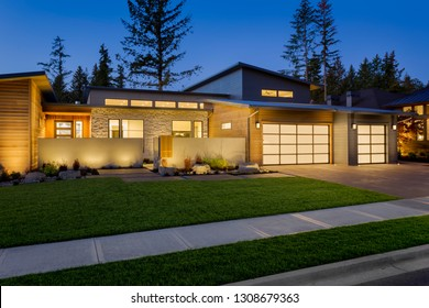 Luxury Home Exterior at Night: Amazing Contemporary Home with Translucent Garage Door Panels and Beautiful Lighting