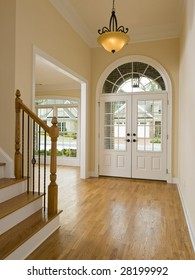 Luxury Home Foyer Door and Staircase with light
