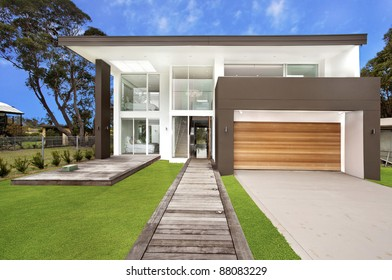 luxury home frontage against blue sky