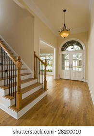 Luxury Home Staircase and Foyer with hanging light