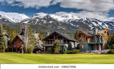 Luxury Homes on Nicklaus North Golf Course in Whistler on a sunny Spring day with Blackcomb Mountain in the background