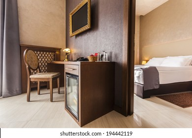 Luxury hotel room interior with mini bar in brown tones
