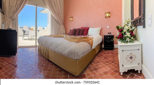 Luxury hotel room in Moroccan style with breakfast on terrace