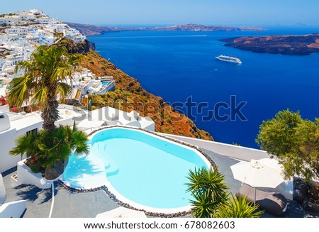Luxury hotel with sea view. White architecture on Santorini island, Greece. Beautiful view on sea and cruise ship