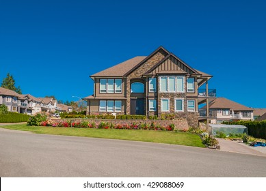 Luxury house in center of the neighborhood with fresh flowers on the front yard
