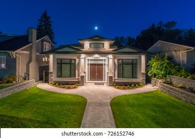 Luxury house, home  at  dusk, night time in suburbs of Vancouver, Canada.