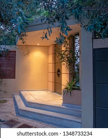 luxury house illuminated entrance metallic door early in the evening, Athens Greece